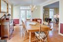 Dining Room with a view of the front porch doors - 25891 MCKINZIE LN, CHANTILLY