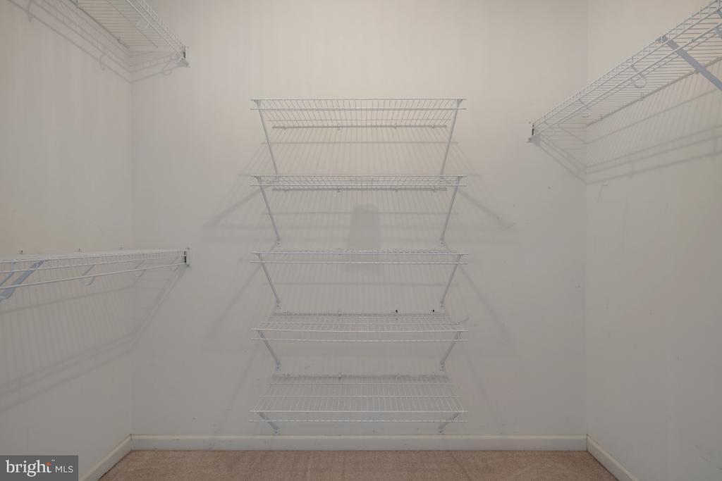 Walk In Closet in the Primary Bedrpom - 513 EWELL CT, BERRYVILLE