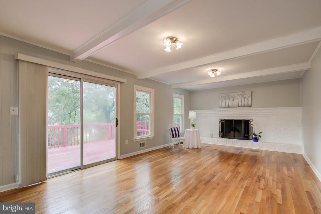 Family room with access to outside deck - 13832 TURNMORE RD, SILVER SPRING