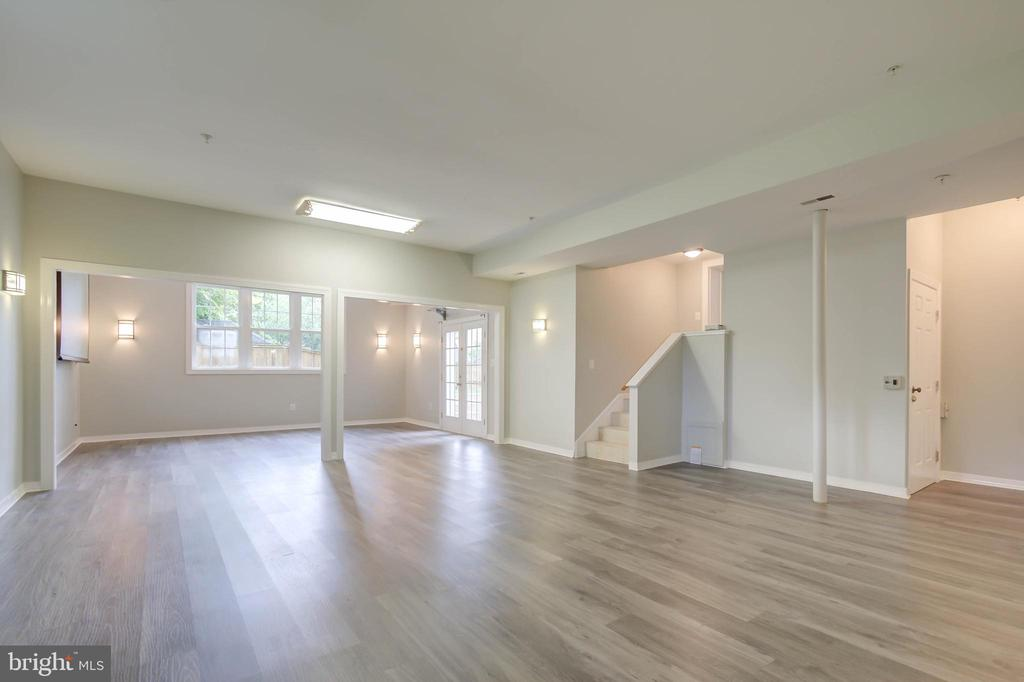 New LVT flooring in the large basement - 13832 TURNMORE RD, SILVER SPRING
