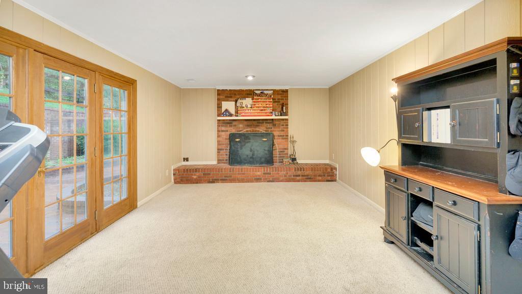 Family Room w/Wood Burning Fireplace & Atrium Door - 2056 FARRAGUT DR, STAFFORD