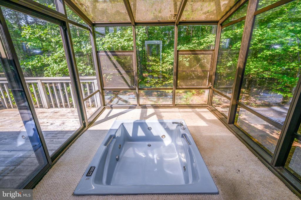 heated soak tub with jets in the glass room - 222 YORKTOWN BLVD, LOCUST GROVE