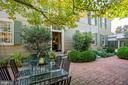 Mature plants surround this large patio - 1501 CAROLINE ST, FREDERICKSBURG