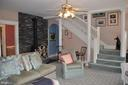 Wood stove with custom stone wall - 11690 FREDERICK RD, ELLICOTT CITY