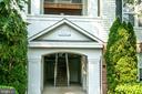 Front entrance of building - 42531 ROCKROSE SQUARE #102, ASHBURN
