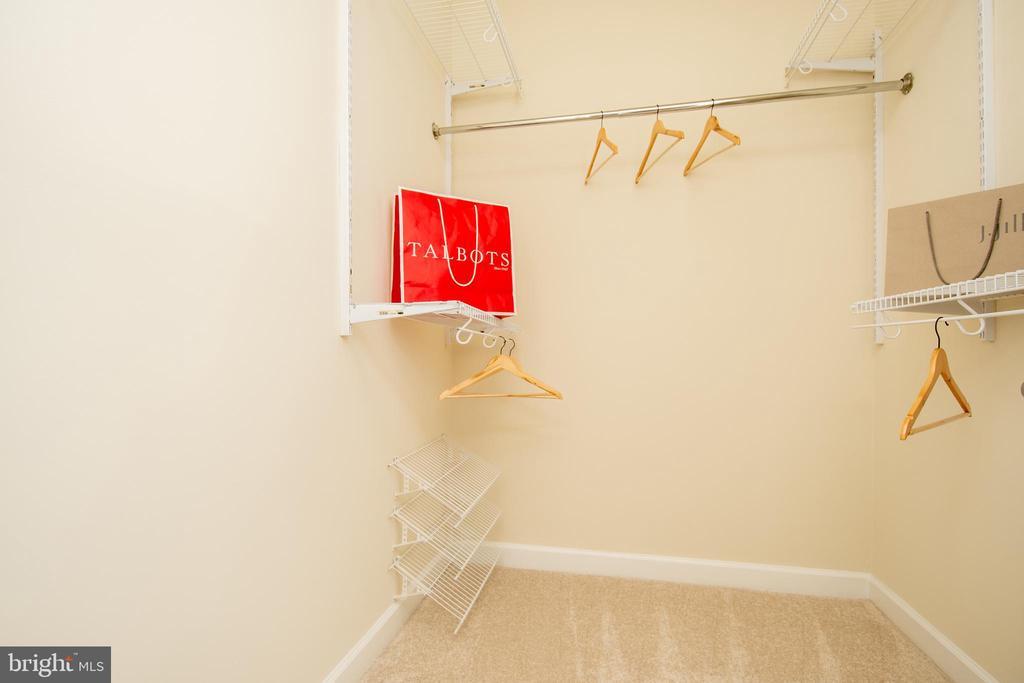 Walk-in closet primary bedroom - 42531 ROCKROSE SQUARE #102, ASHBURN