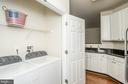 Full size washer and dryer closet in kitchen - 42531 ROCKROSE SQUARE #102, ASHBURN