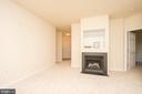 Living room featuring gas log fireplace - 42531 ROCKROSE SQUARE #102, ASHBURN