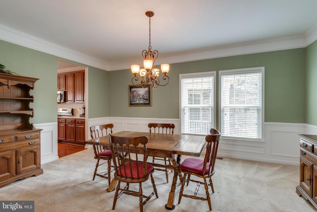 Formal Dining Room with Custom Wainscoting - 42972 THORNBLADE CIR, BROADLANDS