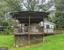 Side view of house w/ Deck - 11291 PINE HILL RD, KING GEORGE