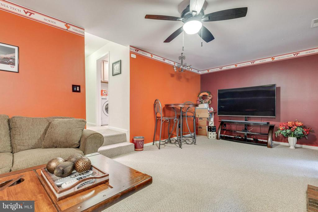 Family room w/ access to back patio! - 7157 LAKE COVE DR, ALEXANDRIA