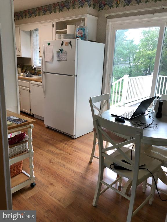 Exit from kitchen onto deck - 4 DONALDS LN, MOUNT AIRY