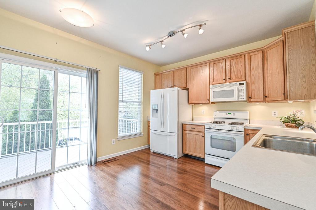 Kitchen features LVP, large walk-out deck - 42791 SMALLWOOD TER, CHANTILLY