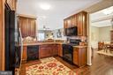 Kitchen - Hardwood Floors & Granite Counter Tops! - 20505 LITTLE CREEK TER #302, ASHBURN