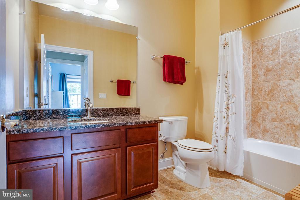 Main level bathroom - tile & granite counters! - 238 LONG POINT DR, FREDERICKSBURG