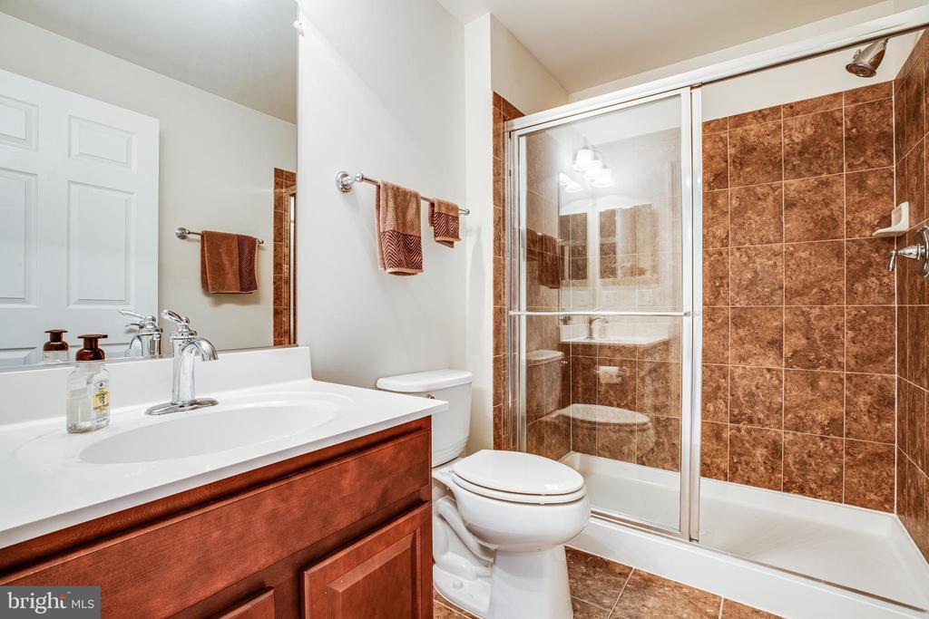 Lower level full bathroom - upgraded tile! - 238 LONG POINT DR, FREDERICKSBURG