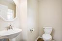 Main level half bath - 67 SAINT ROBERTS DR, STAFFORD