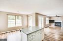 open concept kitchen to the family room - 67 SAINT ROBERTS DR, STAFFORD