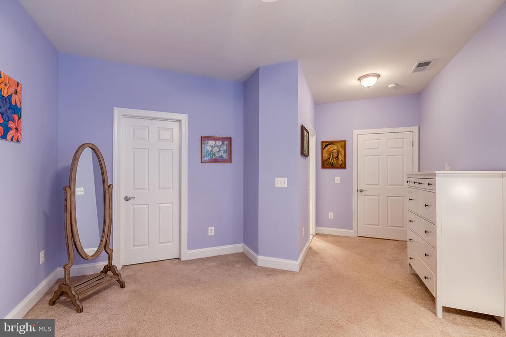 The second Primary Suite has a huge walk-in closet - 8635 LAROQUE RUN DR, FREDERICKSBURG