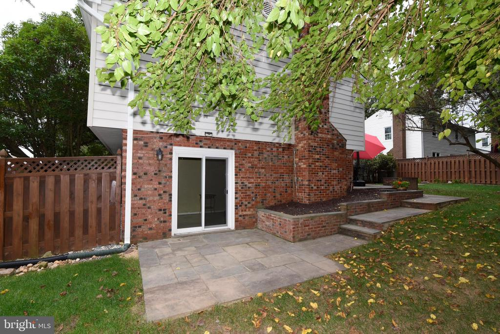 Second stone patio area off lower level - 12818 FANTASIA DR, HERNDON