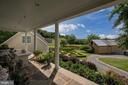 Side Porch View of Guest House Garden - 7549 FINGERBOARD RD, FREDERICK