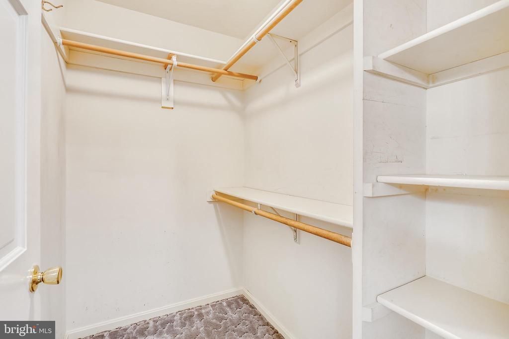 Primary bedroom walk-in closet - 16509 MAGNOLIA CT, SILVER SPRING