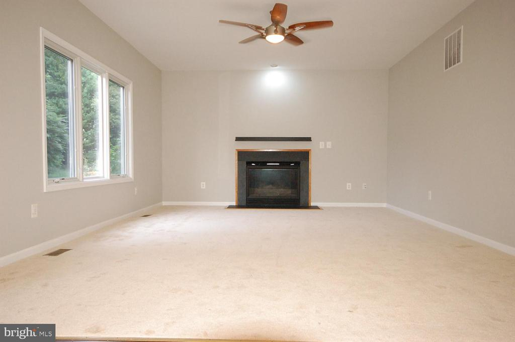 Family room with gas fireplace - 8599 EASTERN MORNING RUN, LAUREL