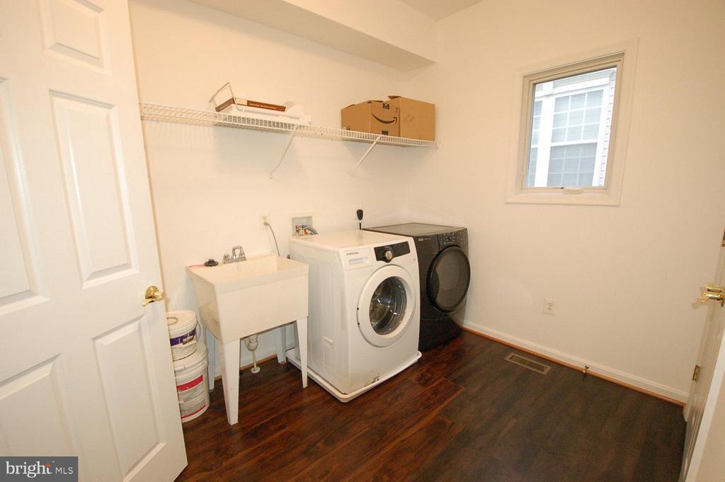 Spacious laundry room on the main floor - 8599 EASTERN MORNING RUN, LAUREL