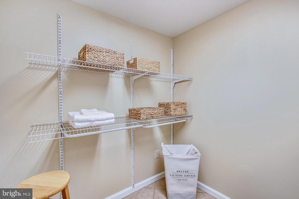 Separate laundry room with shelving - 11955 GREY SQUIRREL LN, RESTON