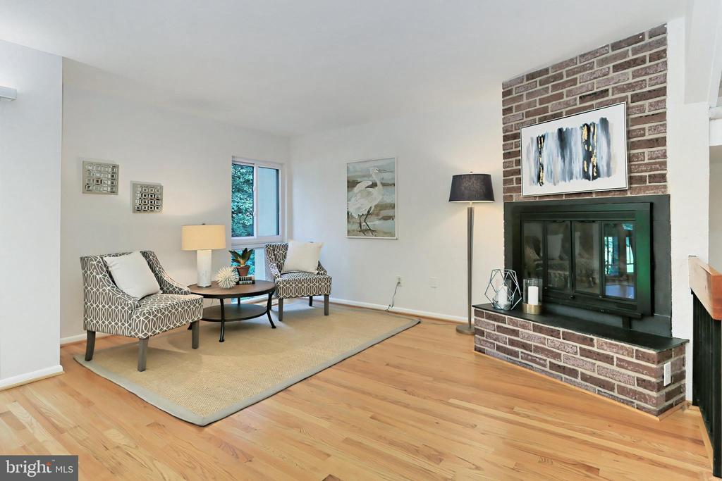 Sitting area for relaxing by the fireplace - 11704 NEWBRIDGE CT, RESTON