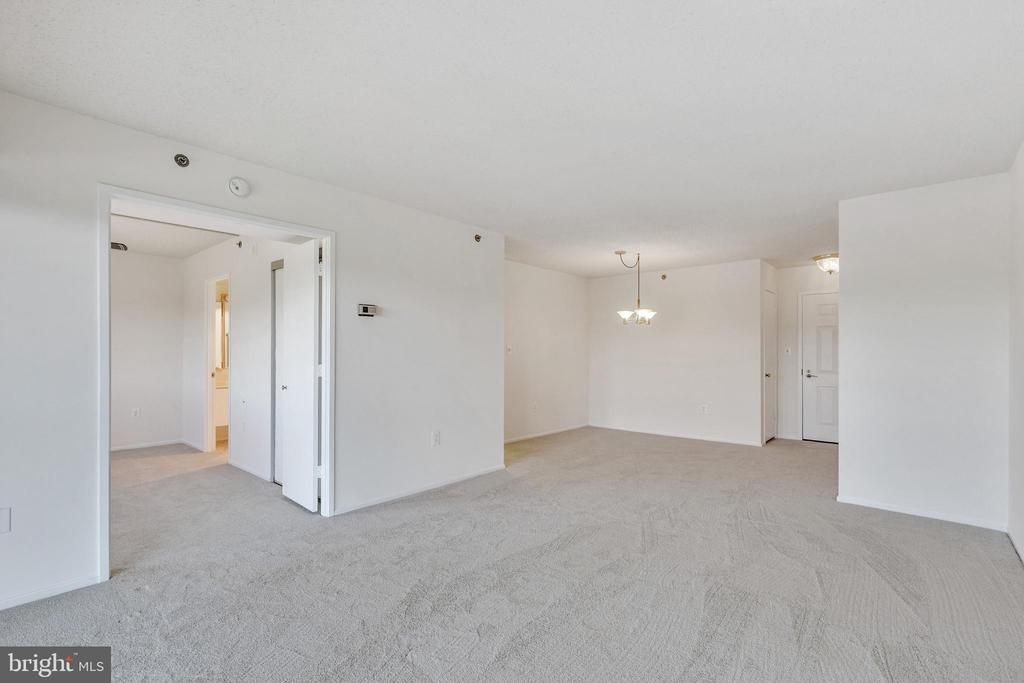 View from living room to dining area - 3330 N LEISURE WORLD BLVD #5-518, SILVER SPRING