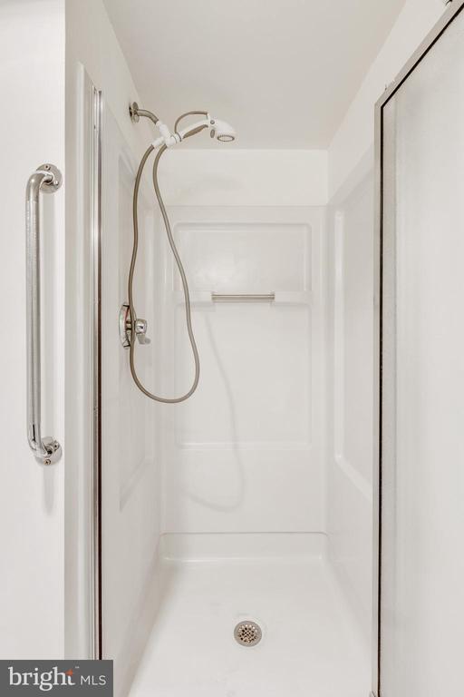 Shower in 2nd bathroom - 3330 N LEISURE WORLD BLVD #5-518, SILVER SPRING