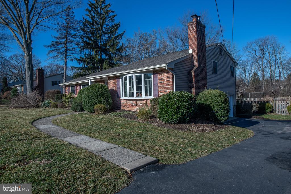 Lovely brick home on beautiful .74 acre level property with In-Ground Pool. This spacious split level home features a large Living Room with a cathedral ceiling, bay window, hardwood floors, and tiled wood-burning fireplace.  A new Eat-in Kitchen/ Dining Room area with electric stove and built-in microwave, glass backsplash and granite countertops, a mini bay window, and a convenient exit to the rear deck perfect for the BBQ. The second floor includes a Master Bedroom with a new closet and a newly updated full bath with a shower.  Two additional generous size bedrooms with great closet space, hall linen closet and remodeled bath with tub. The carpeted lower level features a large family room, updated powder room, and slider to the freshly carpeted three-season sunroom with doors to a gorgeous flat rear yard, patio, and in-ground pool. There is a two-car attached garage, plus an additional detached one car garage with a loft, perfect for workshop, office or studio. Terrific location, near shopping and highways, walk to a park. EXCELLENT VALUE!!!