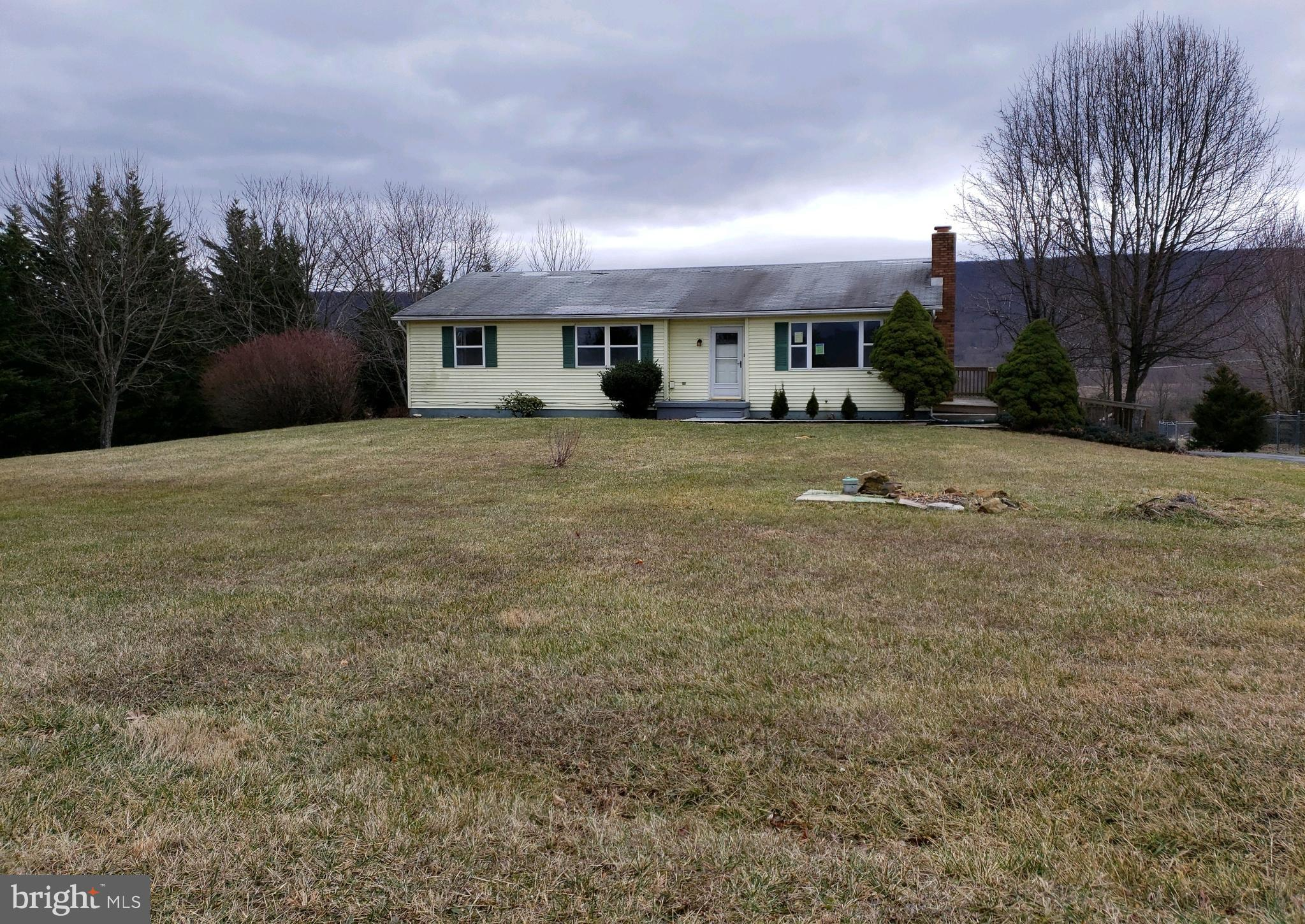 Rancher featuring  3 BR, 3 Bath, home with Additional Kitchen, LR, and Bath inwalkout Basement with attached 2 car Garage, lovely scenic views, country living.