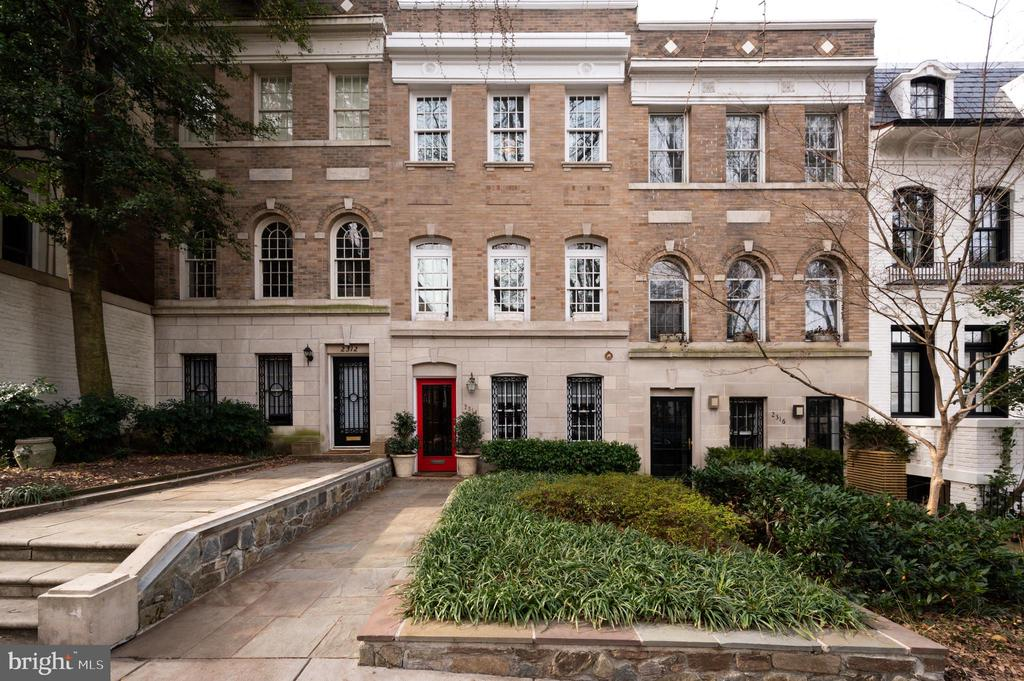Open Sun (3/1) from 1 pm - 3 pm.    A stately, three-level Kalorama town house featuring 3 Bedrooms & 3.5 Bathrooms with a massive private deck and garage on one of the city's most coveted blocks.  This brick and limestone stunner strikes the perfect balance between refined elegance and relaxed luxury.   Featuring nearly 3,000 sq. ft. of living space, with  elegant period details, this home is one of the most sought-after properties in Kalorama.  Luxury features include original detailed woodwork and custom wall paneling throughout.  The home has undergone extensive restoration work, including:  double-pane windows that replicate the originals; new chimneys;  two working wood burning fireplaces with restored original mantels;  a repurposed, 100-year-old chandelier in powder room that is original to the home;  hand-hammered and individually laid fir wood floors that were original to the home and painstakingly restored.    The home also boasts a chef's kitchen, complete with marble counters and Sub-Zero & Viking appliances, as well as a luminous breakfast room off of the kitchen.  Entertain in the gracious dining room, with original mahogany pocket doors, or outdoors on the newly renovated private deck with irrigated planters.  The master bedroom features custom California Closets, a master bathroom with steam shower and a light-filled den off of the master bedroom.  Host visitors in the upper-level guest bedroom featuring a trio of east facing windows and an en-suite bathroom.   The home has a private garage with newer doors.   Walk to Dupont and Woodley Metro stations, Adams Morgan, and Rock Creek Park.