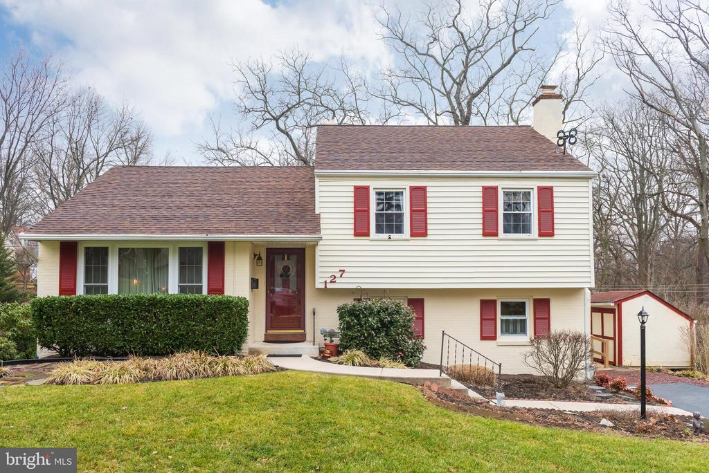 Welcome to 127 Bartholomew Road, a nicely maintained home on a perfectly manicured lot in a wonderful Berwyn neighborhood. The first floor has a foyer with coat closet, living room with crown molding, dining room with wainscoting, crown molding and chair rail & kitchen featuring recessed LED lighting, stainless steel dishwasher/microwave & tiled backsplash. The 2nd floor has a master bedroom with crown molding & double closets, 2 more bedrooms that are served by a hall bath as well as access to the attic. The lower level has a large family room with a gas fireplace & recessed lighting, powder room, laundry area and access to side door. There is a finished basement with another closet and plenty of room for storage. A screened in porch with ceiling fan is perfect for meals with nice weather & the large patio in back is perfect for grilling, entertaining and enjoying the views of the back yard. Walk to the Berwyn Train station as well as RT 30 shops & restaurants. All of this in the award winning Tredyffrin/Easttown School District!