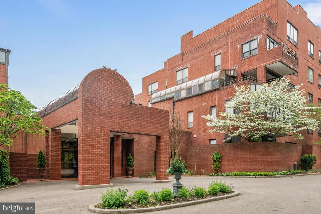 Wonderful 2-level home in Haverford's desirable Cheswold condominium community with views of the Cricket Club! A carefree lifestyle awaits you at 101 Cheswold Lane, one of the Main Line's most prestigious, sought-after living destinations with exceptional amenities. Residents are catered to with a 24-hour concierge, attentive onsite staff, maintenance services, gated parking, package delivery, storage and entertainment room for parties and events. As alluring is the prime location in a great school district, moments to the Merion Cricket Club, walkable to the Haverford train, Haverford Square Shopping Center and Haverford College campus. A short 5-minute drive brings you to the shops at Suburban Square in Ardmore, and restaurants and conveniences of Bryn Mawr. Plus you'll enjoy easy access to Center City, the Blue Route and airport! This generously-sized home's gracious interior begins in the entry foyer with an adjoining walk-in coat closet and powder room. Beyond are comfortable, elegant main rooms for relaxing and entertaining. The living room, accentuated by chair rail moldings, built-ins and hardwood floors, is a perfect backdrop for hosting guests. The large, lovely wainscoted dining room with a columned entryway is open to the living/family room with a wood burning fireplace, wet bar and accesses the covered terrace with views of the Club for seamless indoor-outdoor gatherings. Adjacent to the living room, stretching across the back of the home sits a fabulous sunroom with tiled flooring, white painted brick walls and big greenhouse windows where you can read, sip coffee, or serve cocktails in a serene setting with spectacular views. Not to be outdone is the gourmet kitchen equipped with ceiling-high cabinetry, premium Miele and Sub-Zero appliances, a built-in workstation and china cabinet, butler's pantry, and cut-out window to the dining room for easy serving. Rounding out the main level is an en-suite bedroom that is currently being used as a library. The 