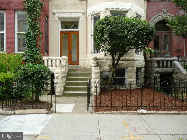 NEW LISTING - Currently leased through July 31, 2020 for $5000/mo.  Rear fencing is set up to allow for parking.  Currently set up as yard space.  Plenty of room for 2 cars.  This is a large scale row house full of wonderful details and character; high ceilings, plaster moldings, oversized windows, etc.  The rear garden is quite large for the location and the block drips with wonderful architecture.  This is a special property!  Pictures were taken several years ago.  No photos now to protect tenants' privacy.