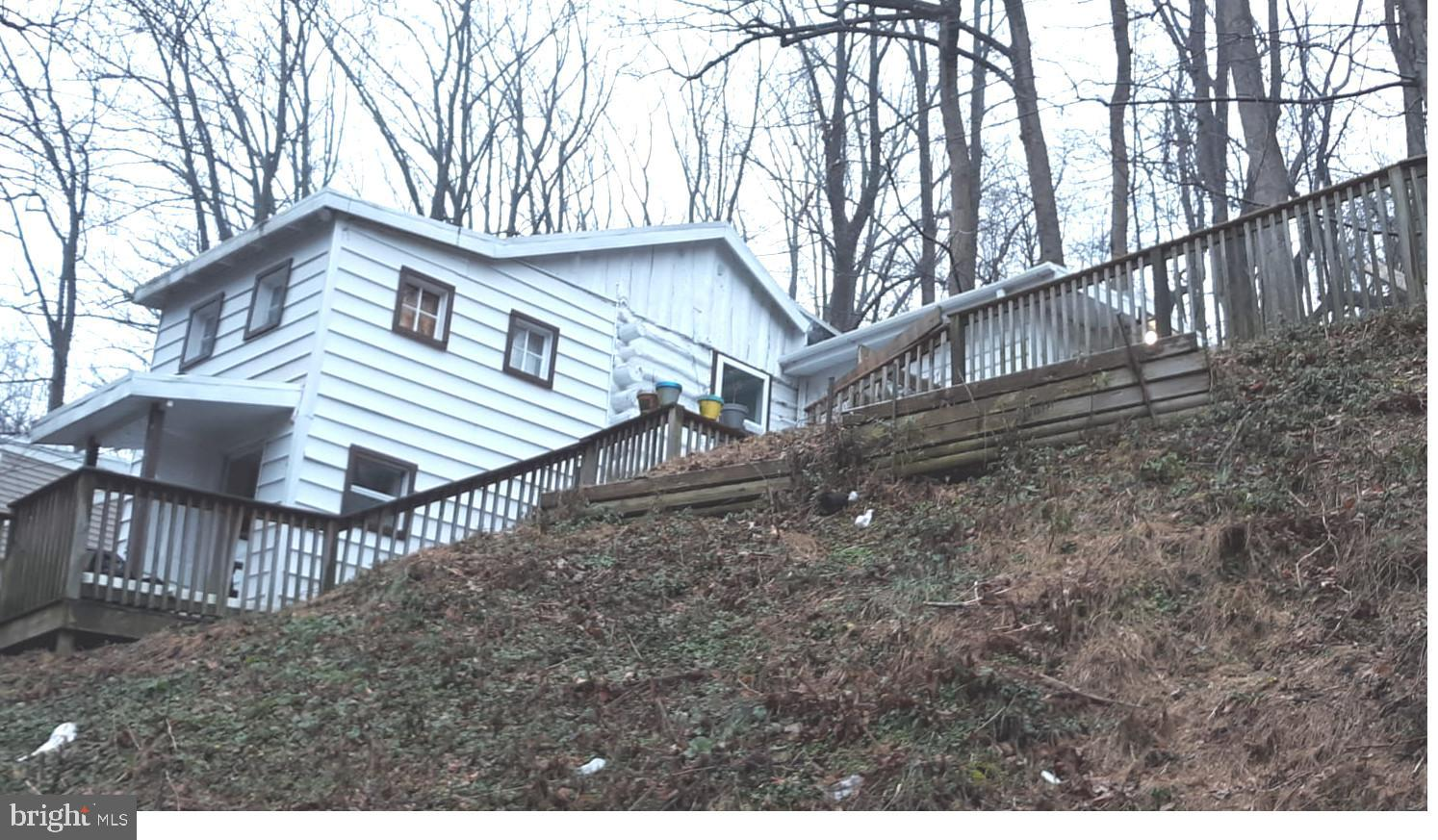 Low cost one story living near the river! Starter home or vacation getaway!  Newer kitchen and bathroom, new carpeting, off street parking, one year home warranty, fenced yard, low taxes. You own the land, .6 acres, washer, dryer refrigerator included.