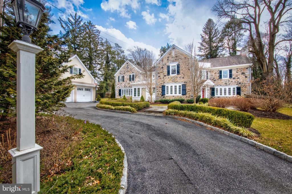 This STUNNING classic stone colonial is the perfect blend of old and new as it  quietly sits on an enchanting private lane in Radnor Township.  No stone has been left unturned as almost every square inch  has been lovingly maintained, expanded and exquisitely updated with the finest of amenities while preserving  its graciousness and nod to the past.  From the moment you arrive, the warmth of this home captures ones soul and you can't help but fall in love with its charming  street presence  and magnificent landscaping.   A circular driveway, boxwood hedges and flagstone walkways lead you into this beauty where understated elegance abounds from the Foyer.  Gleaming hardwood floors carry you from room to room  creating  a natural  flow that seamlessly blends the original part of the home into the  expanded spaces and rooms creating the masterpiece that it is today!! The formal Living and Dining  Rooms boost many architectural features of a by-gone- era like deep windowsills and exquisite moldings and set the tone for the home as it was modernized over the years.  The attention to detail  throughout the entire house  is second to none, but  is most evident in the magnificent gourmet Kitchen , Family Room addition, and Mud Room renovation. From the moment you enter the Kitchen one feels like they are on a luxurious yacht as mahogany  countertops glisten above white cabinetry providing  a rich and warm feeling that gracefully flows into Family and  Breakfast Rooms.  This family friendly space is flooded with natural sunlight and conveniently opens up to numerous flagstone patios and a private backyard  perfect for day to day living and also an entertainers dream.  The First Floor is completed by  a newly finished Mudroom, and Informal and Formal Powder Rooms. The sunny disposition of this property continues up to the Second Floor where a magnificent Master Suite can be found with luxurious Master Bath and his and her walk-in closets. Hardwood floors continue into four  