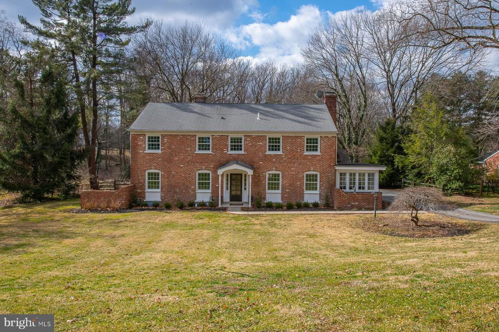 Everything about this Classic, 2 story Brick Colonial invites you to call it your new home. From the landscaped gardens to the private back yard, complete with white picket fence overlooking a beautiful in-ground pool, you will be charmed. Below the pool, the property extends past the fence, to a stream and woods beyond. This accessible oasis is located in the award-winning Radnor school district, on a cul-de-sac that provides entrance for residents to a free arboretum.Indoor are all the characteristics that you expect from a classic center hall colonial- with the added advantage of large rooms all newly painted, refinished hardwood floors, 2 wood burning fireplaces, built-ins, PLUS~new Anderson windows, with transferable warranty! There is a large Living room with fireplace, formal Dining room with French doors leading to the Patio, a cozy Family room with fireplace, a convenient Office space, and a welcoming Kitchen. All of the bathrooms in the house have been taken down to the studs and  updated. The 4 Bedrooms on the 2nd floor are quite large, with generously sized closets. The Master Bedroom is en-suite. The Game room in the basement has been newly painted and carpeted. There is also a laundry area, storage area and egress to the outside. The detached, 2-car, over-sized Garage has a lower level that can be used to store pool equipment and outdoor furniture.Location is a large part of the value of this property. Convenient to trains, major highways, great shopping and scores of restaurants, you have access to every convenience imaginable. The seller is also offering a 1-year Warranty! There is so much about this house and property to appreciate, you will want to come to see it for yourself.