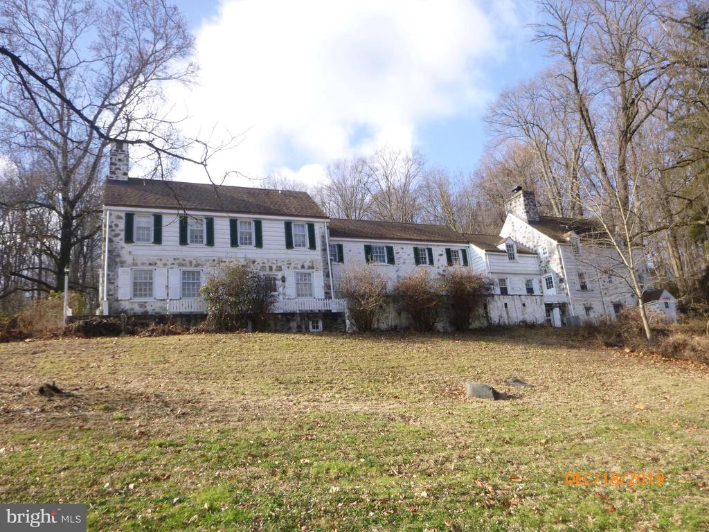 Looking for a home with some history? Step into the past!  This 18th century stone Farmhouse located on a private gated lane has 2.16 acres of land and a creek .  Originally built in 1790, total renovation in 1928 by Architect Brognard Okie, updated again in 2003.   The home includes 7 bedrooms, 6 1/2 bathrooms,  6142 square feet,  4 fireplaces, built-in carpentry, a library, a flagstone veranda, 4 zone air conditioning  and a 3 car detached garage. The basement has a few rooms including a large room that was previously finished with a fireplace & bar, but it needs work.  Plenty of parking...  The back addition can be part of the house but is a legally zoned apartment, which can be rented, used as part of the house, or as an in-law suite. The divider doors inside can be locked and there is a separate entrance from outside.
