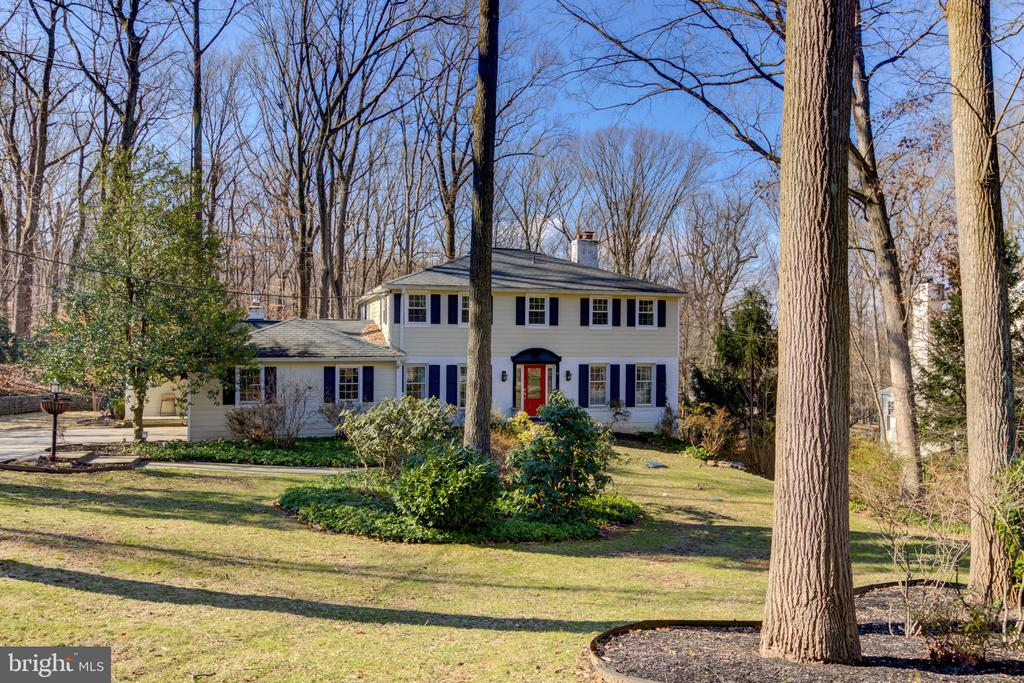 """Great new listing on a cul de sac street in a great Tredyffrin neighborhood!. This beautiful colonial has been completely updated and expanded with no detail spared!  The open  gourmet kitchen has custom creme cabinets, GE Monogram appliances, granite and quartz countertops, beautiful wood floors, a large island with seating for 5 plus an additional breakfast bar.  There is an abundance of storage including two pantry closets. The kitchen opens to one family room with beautiful built-ins around a gas fireplace and TV, and a second family room addition out the back that has numerous large windows for great views of the yard.  This room, with built-ins and a window seat,  has a door to the charming covered deck, and another door to the large deck and yard. There is a lot of living space on the main level - in addition to the two family rooms, there is a large formal dining room, a huge living room with fireplace and French doors to covered deck, and a library/office with built in shelves.  There is also a mudroom of your dreams with a huge walk in closet, a large desk area, lockers, a pet feeding station and spacious laundry room with tons of cabinets. There is also a beautifully renovated full bath with gorgeous tiled shower and a unique mosaic vessel sink.  The stunning master suite has a beautiful luxury bath, two large walk in closets, and a bedroom with great views of yard. This room is truly a """"wow"""" room and you will never want to leave!, There are 3 additional spacious BR's plus a nicely updated bath on this level as well.  The expansive full finished walk-out basement has new carpet and two doors to the outside.  There is great outdoor space with the covered deck, large maintenance free deck, private vegetable garden and so much more... .  This home is 5 minutes to trains, major highways and shopping, yet it is in the nice quiet neighborhood - convenient yet private! This home is not one to miss!!"""