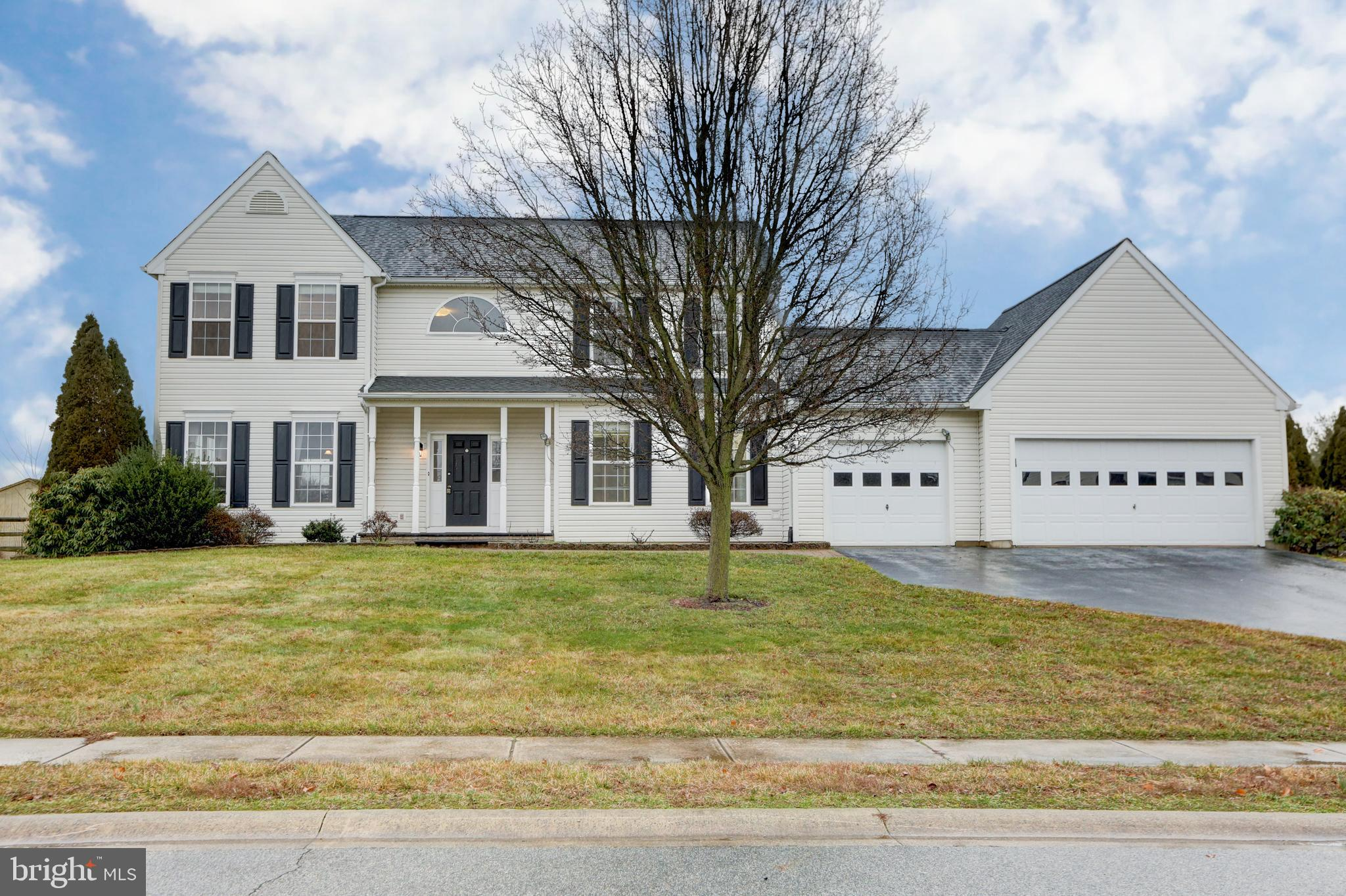 New listing on 3/4 acres in the Appo District! Located in the popular Brick Mill Farm development in Middletown, this gorgeous four bedroom home right near town, but not in the town limits (No town taxes)! The property is situated on a spacious lot with a rear, screened deck perfect for relaxing and entertaining! Enter the main level and take in the beautifully designed layout including an open, 2-story foyer with a bright living room to the left that flows nicely into the dining room. Towards the back of the main level is the updated eat-in kitchen complete with gorgeous white cabinets, updated marble counters, a farmhouse sink, double oven, and a beautiful tile backsplash that brings the whole space together.  An airy breakfast room with a complimenting skylight window sits next to the kitchen. The family room features a beautiful gas fireplace and provides access to the rear screened deck and fenced in yard. Also located on this floor is the spacious laundry room, a convenient powder room, and access to the 3-car garage & oversized driveway. Make your way upstairs and you'll find four bedrooms including a master suite complete with an en suite double sink bathroom with a soaking tub, and a large walk-in closet! Another full, double sink bathroom is located in the upstairs hallway. That's not all! The home also has a fully finished basement with bonus storage space! Professionally staged and move-in ready! Sold on this house?! Schedule your tour today!