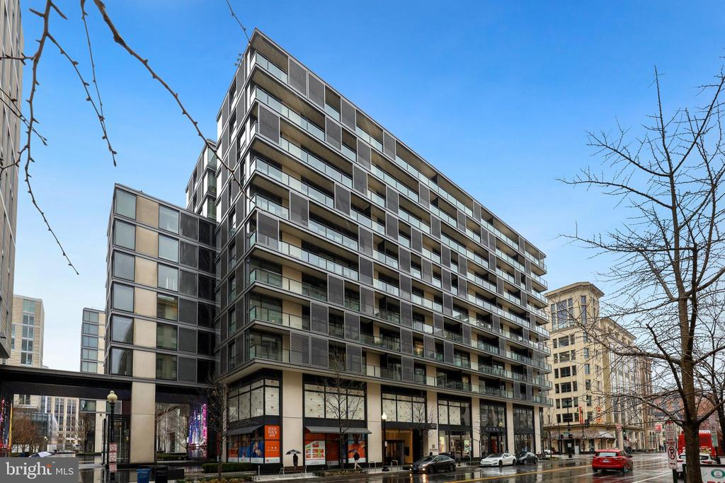 Luxury living in the heart of CityCenter! This modern condo is the largest 1 bed/1 bath unit in the complex with an open floor plan, gorgeous european hardwood floors, and designer finishes throughout! Floor to ceiling windows drench the unit with plenty of natural light. Gourmet kitchen features sleek Molteni cabinetry, expansive Caesarstone island/breakfast bar and high-end stainless steel appliances. Spacious master suite boasts custom closets and glass enclosed shower/tub and vanity separated from the toilet. Washer/dryer in-unit. The foyer has a built-in desk with network/power connections and shelves that are perfect for remote working days.The Residences at City Center, a LEED certified building, offers 5 Star services and amenities such as 24 hour concierge, gym, doorman, 2 green rooftops with gas grills and fire pit, club room, conference room and more. Centrally located near 3 metro stations with world-class dining and designer shops at your doorstep.