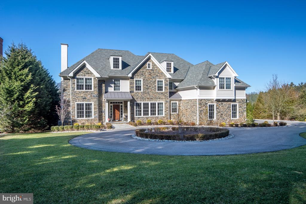 Check out our video: https://www.youtube.com/watch?v=k5cN1LYo7Gw | Custom beauty by Pennstone Homes, built in 2017 to the highest standard of quality, on nearly an acre of picturesque grounds in prime Gladwyne. This 6 bed, 4.2 bath transitional-style gem in the sought-after Fenimore development is completely move-in ready and feels like brand new! It~s an elegant, easy-to-live-in family home that also offers a great flow for formal indoor-outdoor entertaining. Very spacious for any need or occasion, yet exudes a warm, intimate feel that~s just as perfect for relaxing times. The setting is premier, positioned far back from the road, screened by mature trees from the original farm. Live amidst an upscale community, on your own quiet, private grounds complete with spectacular rear views and sunsets as your daily pleasure. Stunning vistas stretch over acres of Fennimore open space; and adjacent are the Bridlewild trails, accessible from the common area. A hemlock tree-lined driveway, circular drive, striking fa~ade with custom natural mica stone blend, and 3-car garage with wood carriage-style overhead doors heighten curb appeal. Two generous stories plus a walkout lower level are appointed with the finest designer finishes, site-finished oak hardwoods, custom millwork, fireplaces & impeccable details. The classic Main Line Colonial living/dining floorplan is modernized with an expansive open kitchen/breakfast room/family living area sought by today~s buyer. Premium cabinetry, white quartzite countertops, subway tiled backsplash, Sub-Zero, Wolf & Bosch appliances, butler's pantry with wet bar & big pantry-workstation with built-in desks & cabinetry punctuate the chef~s quarters. Gather & relax in the light-filled coffered ceiling family room, and read or work in peace in the office. Ultra-convenient & lovely is the large mudroom off the family entry with built-in bench & cabinets. There~s a retreat for everyone upstairs as well with a vaulted master suite, his & her custom closets, luxurious bath with soaking tub & thermostatic spa shower, 4 additional bedrooms with plush Masland carpeting, 3 full baths & huge recreation room or 6th bedroom. Living continues on the walkout lower level with 9~ ceilings, multipurpose space & plumbing for a full bath. State-of-the-art 4-zone HVAC, gorgeous yard with flagstone patio & desirable location take it over the top! Just minutes from top Lower Merion schools, highways, trains, parks, walking trails & more. Close to Shipley Fields & the Village of Gladwyne, and a short ride to Center City & the airport.