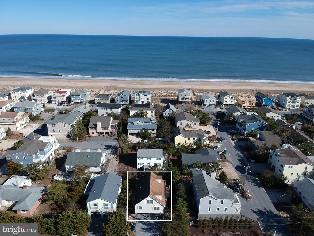 Charming Oceanblock home, just steps to the beach in South Bethany. Enjoy this furnished 4 bedroom, 2.5 bath beach house which features an open floorplan that is wonderful for entertaining and offers an abundance of natural light. Entering the home, you are greeted by the living room which flows into the dining room and kitchen. The main floor also has 2 bedrooms and a full bath along with a delightful screened porch and a large, sun-filled wraparound deck. Upstairs provides 2 additional over-sized bedrooms and a second full bathroom. Along with plenty of parking, on the ground level, there is an outdoor shower and storage closet to make trips to and from the beach a breeze. This property is situated just 4 homes off the beautiful wide lifeguarded beach, a short walk to shopping and restaurants in South Bethany or a quick bike ride to downtown Bethany.  This would be a lovely home to spend the summer with family at the beach or an excellent investment with a proven rental history.