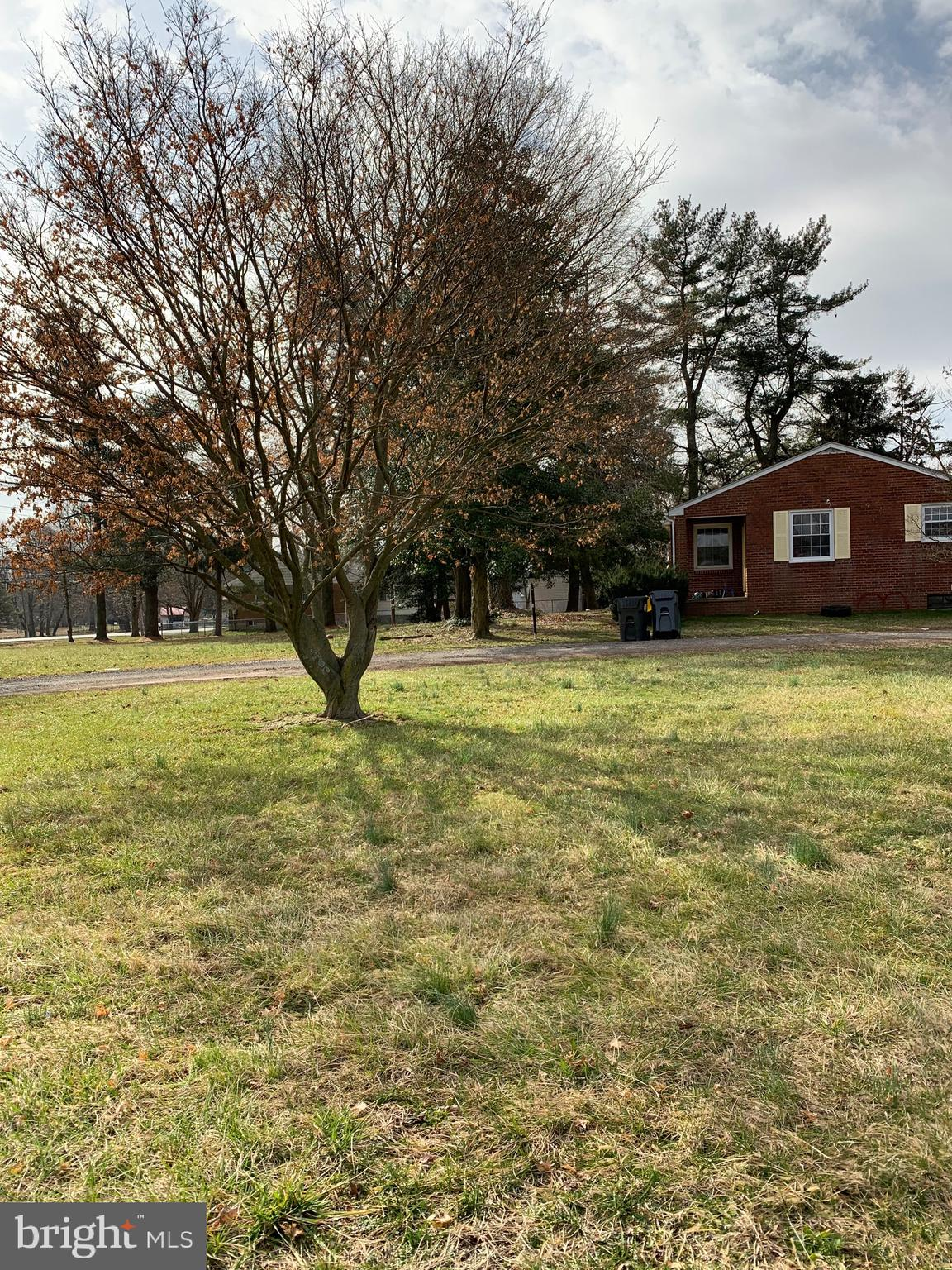 This 3 bedroom one bath ranch home sits on a 1.0900 acre lot along with 3 additional tax parcels totaling 6 acres of land .  The home that sits on the land has central air, oil heat that may be converted to heat pump, public water and septic system.  The home is  brick and situated nicely on the lot.  Being sold all together on one blanket deed. However, new a owner can  separate the deeds, build or use your creativity.  Bring  your offer as soon as possible.  Currently tenant occupied, but not a problem.