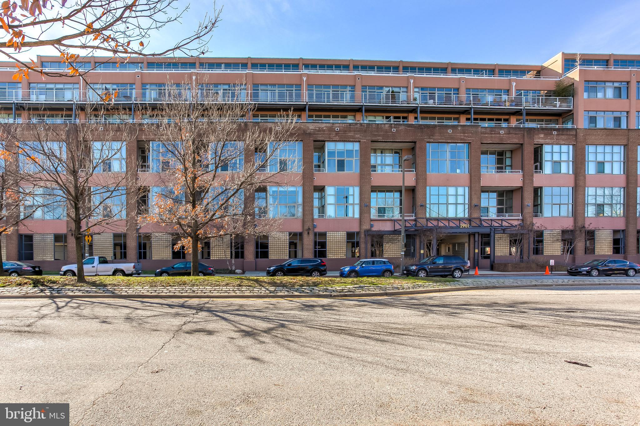 Stunning condo located in Canton Cove on the waterfront featuring panoramic cityscape views from floor to ceiling, wall to wall windows and covered balcony that stretches the length of the unit!  This home offers 3 bedrooms, each with balcony access, and 2.5 baths, including the Owner's suite with gas fireplace, custom walk-in closet, and deluxe full bath with marble tile, dual rain head shower, jetted tub and bidet. Beautifully updated kitchen features marble counters, island, black and stainless steel appliances and classic white cabinets.  Elegant formal dining room leads to a sundrenched living room boasting a cozy wood fireplace and a wall of windows with access to balcony.  Enjoy rooftop access for fireworks and parties, 2 assigned parking spots in private lot.   Stroll the Canton waterfront and visit the shops and restaurants in and around the square  as well as nearby Fells Point and Harbor East. This home is impeccable & move-in ready today!
