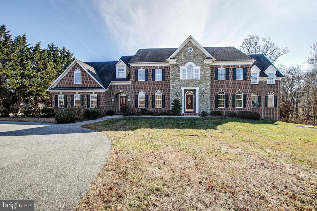 AGENTS - BUYERS must preview all online videos/pictures prior to requesting a Showing. PreApproval must be received by Listing Agent, Kisha Martin-Burney at Kisha.MartinBurney@Compass.com, prior to scheduling an appointment. Welcome to this stunning Custom-Built Montgomery County Estate Home offering 7 Bedrooms, 6 full baths and a powder room off the Gourmet kitchen on the main level.   The Grand foyer welcomes you with marble flooring and floor-ceiling windows.  The main level has gleaming hardwood floors throughout, 2-story ceiling in the Great room with Gas fireplace featuring the beautiful floor-ceiling stone surround just off the Gourmet kitchen.  The main-level suite offers a full bath, ample closets and full ADA-compliant bath equipped with safety bars, with granite countertop and natural cherry vanity cabinetry.  The upper level features the owner's wing - the bedroom has a tray ceiling with Tiffany light fixture, 2 walk-in closets (for him), and a luxurious bath with oversized soaking tub, separate shower, granite vanity tops and natural cherry cabinetry. Just off the bedroom is a spacious sitting area with electric fireplace and wetbar. The custom closet (for her) features two separate (seasonal) areas with built-in shelving and floor-ceiling mirror - words cannot describe - seeing is believing.  The fully-finished walk-out basement offers 2 bedrooms, 1 full bath,  theatre room wired for surround sound, a fitness room and ample storage.  Comfort is not an issue in this home, with 2 Gas HVAC units for the main and lower levels, and an electric heat pump on the upper level.  Never run out of hot water with the oversized gas hot water heater equipped with an expansion tank.  Shown by Appointment Only to serious Pre-Approved buyers. Covid Restrictions - Mask must be worn at all times while inside the home. No more than 3 people in the home at a time.